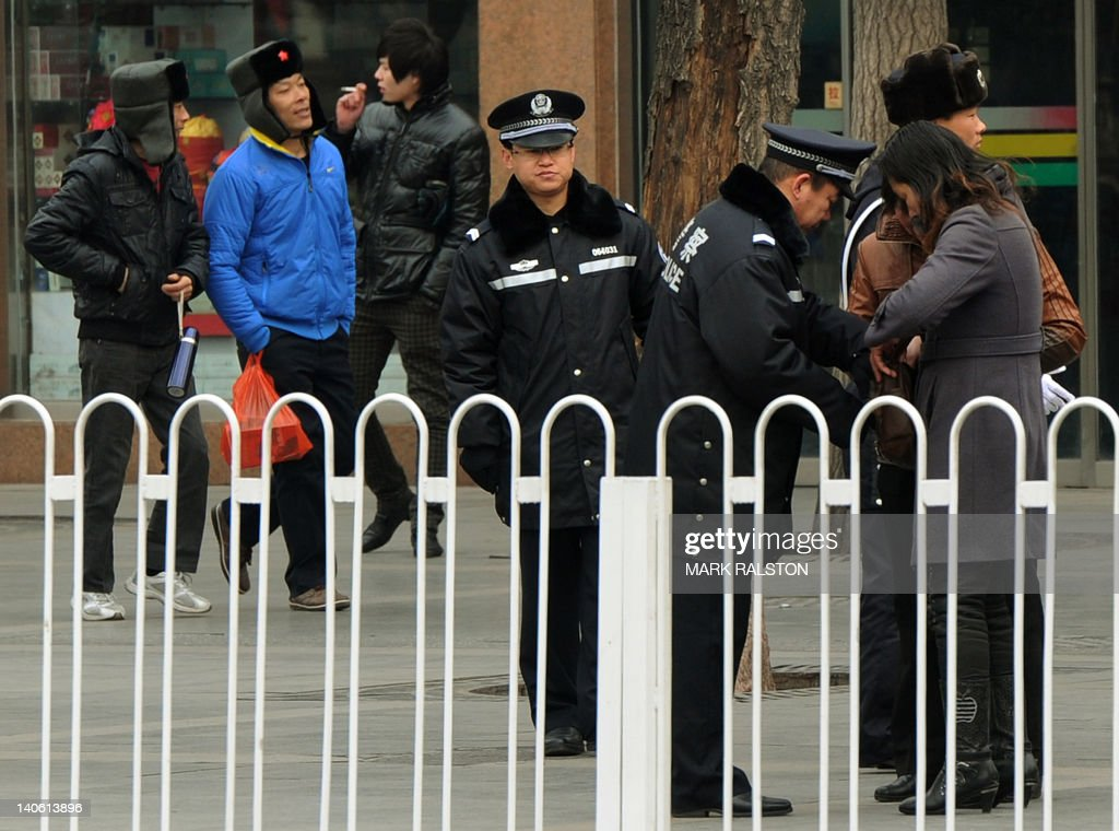 Police Search People Outside The Great Hall Of The People