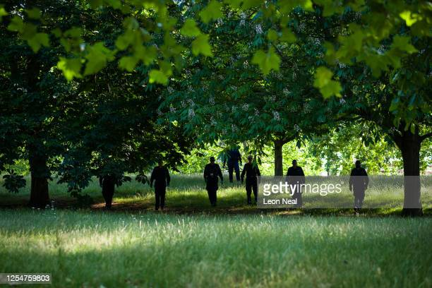 Police search teams secure the area around the 7/7 memorial in Hyde Park ahead of a wreath laying to mark the fifteenth anniversary of London...