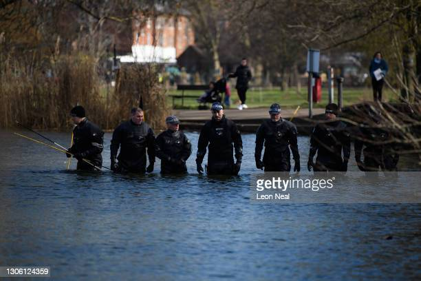 Police search teams work their way through Mount Pond on Clapham Common as the hunt for missing woman Sarah Everard enters its fifth day, on March...