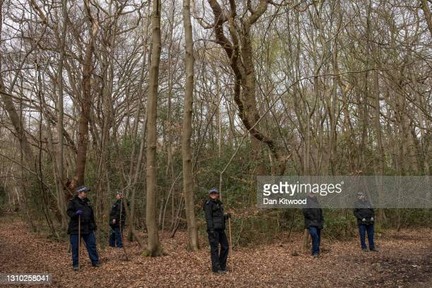 Police search teams work their way through woodland in Epping Forest on April 01, 2021 in Epping, England. Richard Okorogheye, a 19-year-old student...