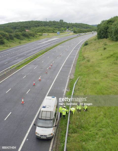 Police search the bank alongside the hard shoulder of the deserted southbound carriage way of the M5 motor way near Dursley after a body of a woman...