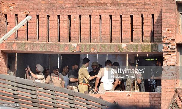 Police search the building after successfully completing their mission against gunmen who attacked a police station at Dinanagar on July 27 2015 in...