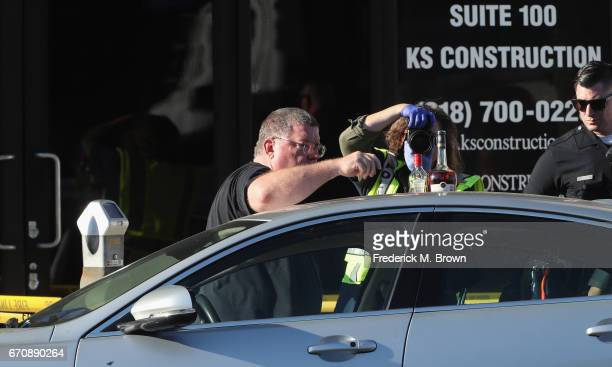 Police search the car where singer Cuba Gooding Sr was found dead on April 20 2017 in Woodland Hills California Gooding was 72 years old