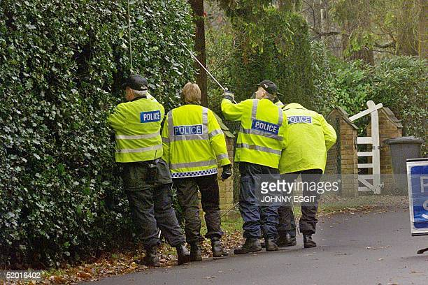 Police search the grounds 11 December, as Chilean leader Pinochet prepared to leave his hide-away in Wentworth heading for a top-security court where...