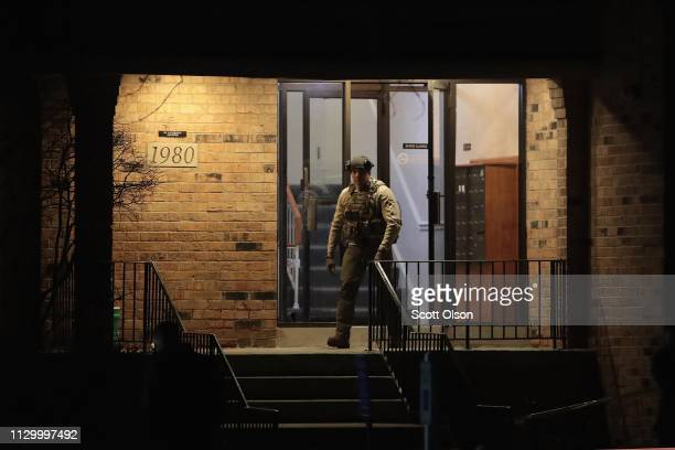 Police search the home of Gary Martin a 45yearold man who was killed by police after he opened fire at the Henry Pratt Company on February 15 2019 in...