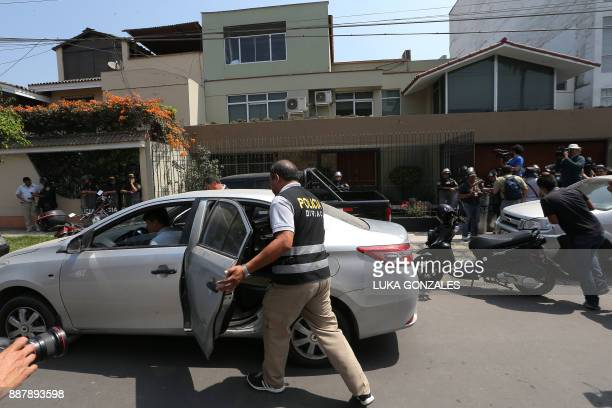 Police search the offices of Peru's Fuerza Popular party in Surco a district of Lima on December 7 2017 Peru's public prosecutor's office searched...