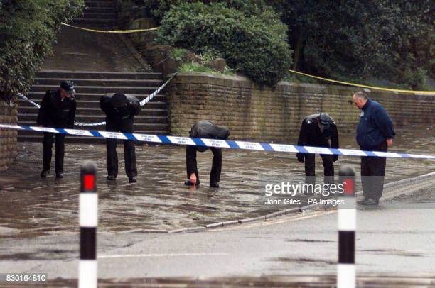 Police search the pavement near Rochdale Town Hall after a number of shootings Six people were being treated for gunshot wounds following three...