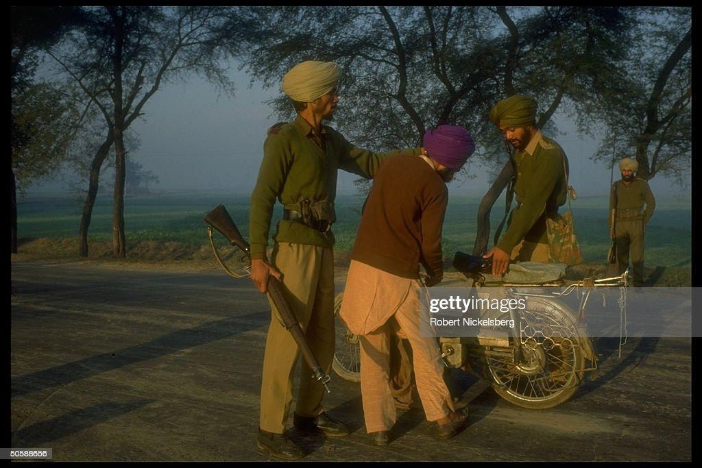 Police searching local men Bhikhiwind Punjab