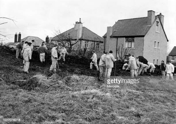 Police searching the ground behind the home of Peter Sutcliffe in Bradford following his arrest. 9th January 1981.