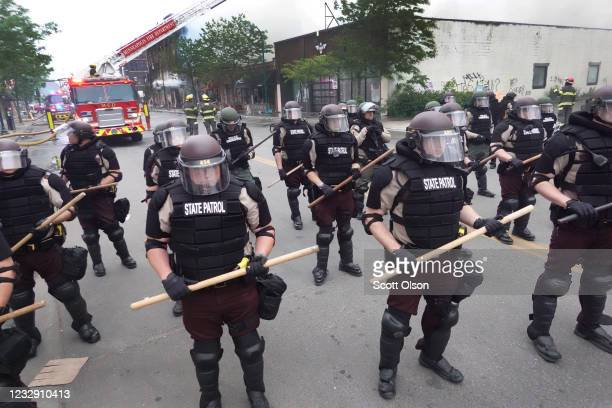 Police secure a perimeter following a night of rioting sparked by the death of George Floyd while in police custody on May 29 2020 in Minneapolis...