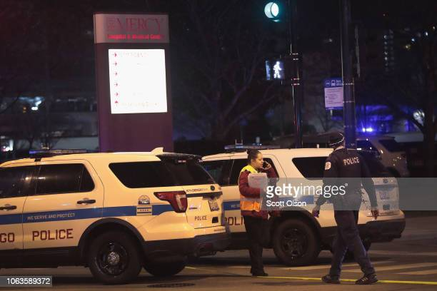 Police secure an area around Mercy Hospital after a gunman opened fire on November 19 2018 in Chicago Illinois A police officer the gunman and at...