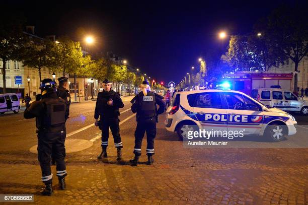 Police secure the area after a gunman opened fire on Champs Elysees on April 20 2017 in Paris France One police officer has been killed and a second...