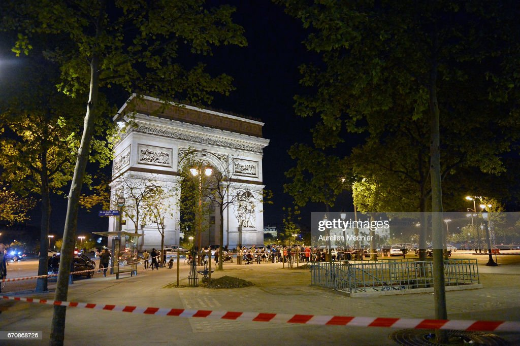 Police secure the area after a gunman opened fire on Champs Elysees on April 20, 2017 in Paris, France. One police officer has been killed, and a second injured by a gunman on The Champs Elysees. Security is heightened in Paris with the first round of France's presidential election on Sunday.