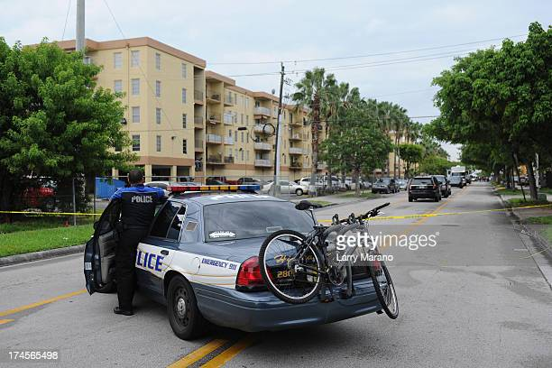 Police secure the area after a shooting incident at an apartment complex on July 27 2013 in Hialeah Florida Police have identified 43yearold Pedro...