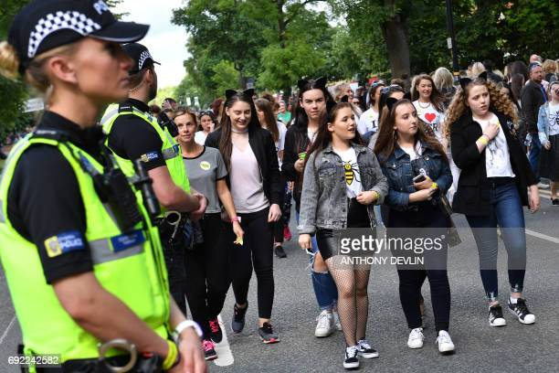 Police secure the area as fans begin to arrive at the Old Trafford Cricket Ground ahead of the One Love Manchester tribute concert in Manchester on...