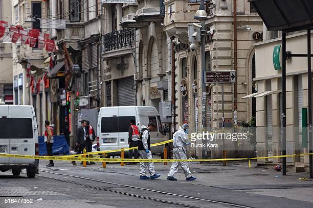 Police secure the area as forensics inspects the blast site following a suicide bombing in a major shopping and tourist district in the central part...