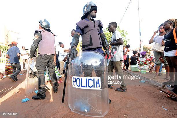 Police secure the area during the closing campaign rally for independent presidential candidate Nuno Gomes Nabiam May 16 2014 in Bissau GuineaBissau...