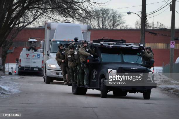 Police secure the area following a shooting at the Henry Pratt Company on February 15 2019 in Aurora Illinois Five people were reported dead and 5...