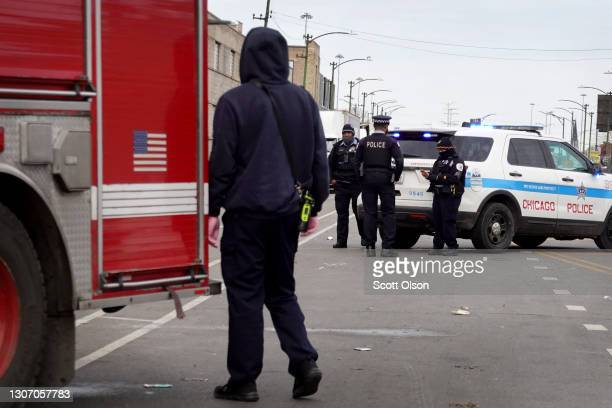 Police secure the crime scene following a shooting at a tow company garage where at least 15 people were reported to have been shot, two fatally, on...
