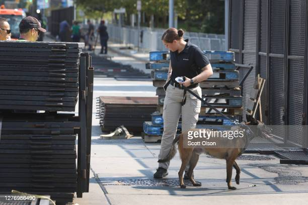 Police secure the perimeter as they prepare for the first presidential debate between US President Donald Trump and Democratic presidential nominee...