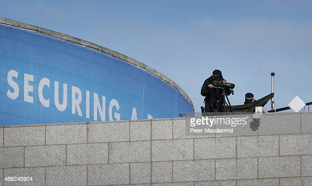 Police secure the roof of the Conservative party conference on September 28 2014 in Birmingham England The governing Conservative party are holding...
