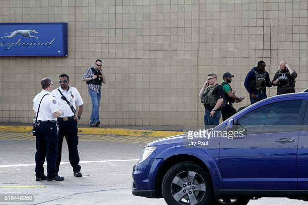 Police secure the scene of a shooting at a Greyhound bus station March 31 2016 in Richmond Virginia A gunman was killed and a Virginia state trooper...