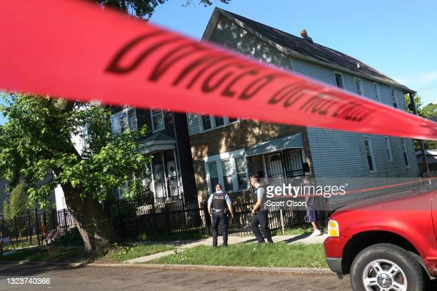 Police secure the scene of a shooting on June 15, 2021 in the Englewood neighborhood of Chicago, Illinois. Four people were killed at a home during...