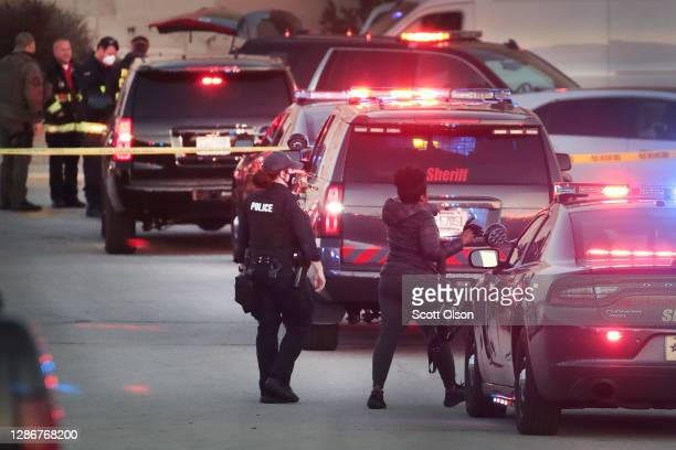 Police secure the scene outside the Mayfair Mall after a gunman opened fire on November 20, 2020 in Wauwatosa, Wisconsin. Several people were...