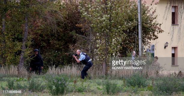 Police secures the area between Wiedersdorf and Landsberg near Halle eastern Germany where shots were fired on October 9 2019 At least two people...
