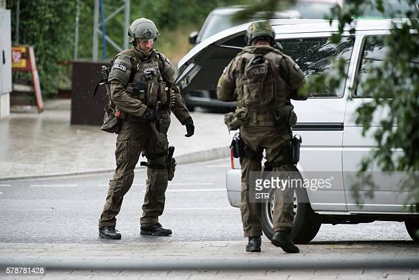 Police secures the area outside a shopping mal the Olympia Einkaufzentrum in Munich on July 22 2016 following a shooting At least one person has been...