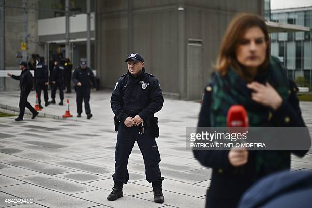 Police securie the perimeter outside a court as journalists cover the arrival of the former Portuguese Prime Minister Jose Socrates at the Campus de...