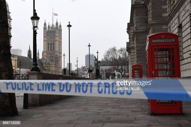 TOPSHOT A police security cordon remains around the Houses of Parliament on March 23 2017 in London Seven people have been arrested including in...