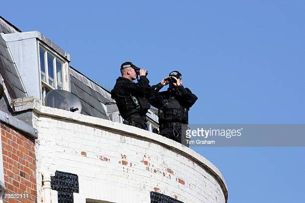 Police security keep watch during Queen Elizabeth II and Prince Philip, Duke of Edinburgh's visit to Brighton on March 8, 2007 in Brighton, England.
