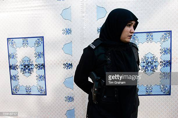 Police security looks on at the all female Fatima Jinnah University during the royal visit on October 31, 2006 in Rawalpindi, Pakistan. Prince...