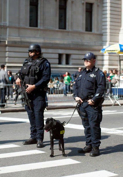 NYC Police security patrol with machine gun and police dog.
