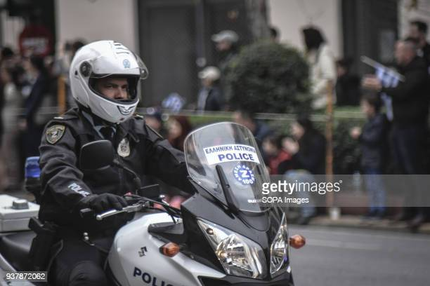 Police seen driving motorcycle during the parade Military parade in Athens for The Greek Revolution or Revolution of 1821 was a successful armed...