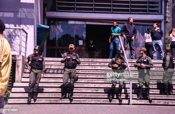 Police seen guarding a store to maintain order The government of President Nicolas Maduro ordered to regulate the prices of products in more than 26...