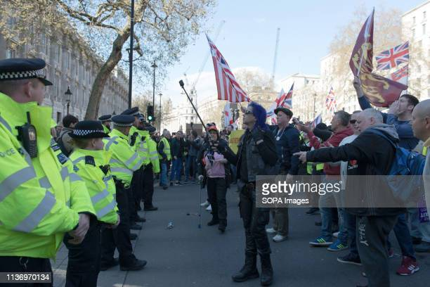 Police seen standing in front of protesters during the demonstration Protesters gathered at Parliament Square and marched to different places...