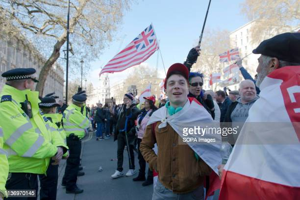 Police seen standing in front of protesters during the protest Protesters gathered at Parliament Square and marched to different places including...