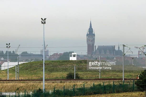 A police sentry stands guard in an observation post looking over the fortified railtracks of the Channel Tunnel train service on September 6 2016 in...