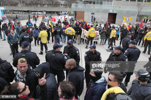 Police separate opposing groups of protestors during a rally against Islam Muslims and Sharia Law in downtown Toronto Ontario Canada on May 06 2017...