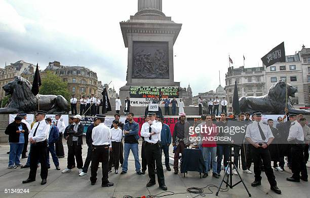 Police separates Nationalists from muslim devotees during the 'Rally for Islam' at Trafalgar Square in central London 25 August 2002 Some 400 hundred...
