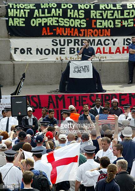 Police separates Nationalists waving English and US flags and muslim devotees during the 'Rally for Islam' at Trafalgar Square in central London 25...