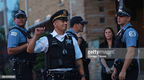 A police sergeant instructs officers at a crime scene on the 7300 block of South Merrill Avenue Thursday July 28 in Chicago A foot chase by police...