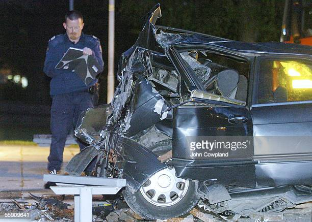A police serious crash investigator examines a car that crashed into the wall of the Hastings Exhibition Centre following a short police chase...