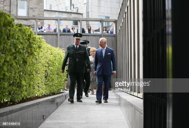 Police Service of Northern Ireland Chief Constable George Hamilton and Prince Charles Prince of Wales arrive at the opening of the memorial garden at...