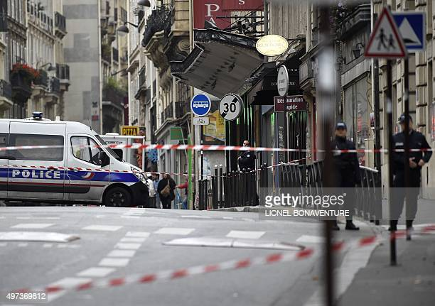 Police set up a cordon around the area where a suspect package was found in Rue De Clichy in the ninth district of Paris on November 16 as France...