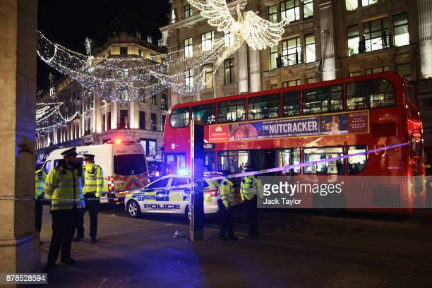 Police set up a cordon on Regent Street and Oxford Circus underground station on November 24 2017 in London England Police are responding to reports...