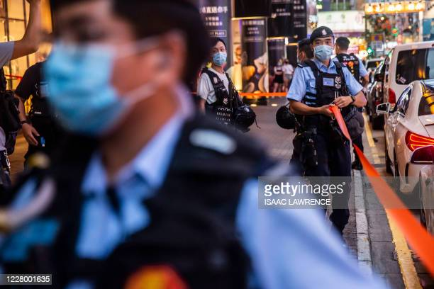 Police set up a cordon outside after people were protesting for press freedom inside a mall in Hong Kong on August 11 a day after authorities...