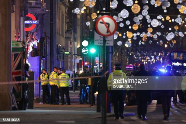Police set up a cordon outside Oxford Circus underground station as they respond to an incident in central London on November 24 2017 British police...